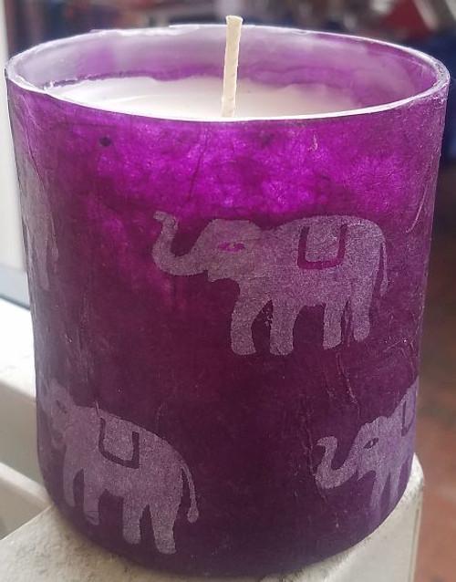 Silver elephants on purple Lokta paper.  Lokta paper is handmade in Nepal