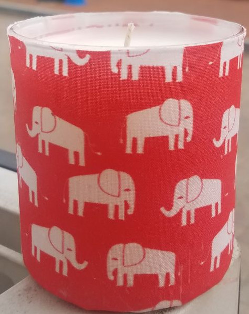 This fabric has white elephants on a Red background