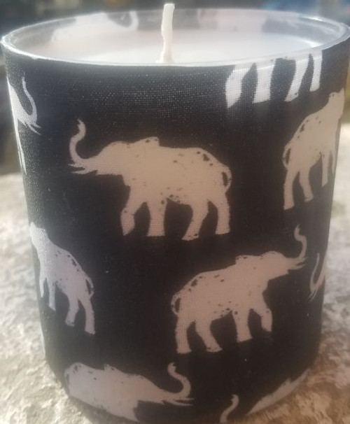 This is black background fabric with white elephant images with tusks up