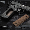 Simonich Gunner Military Brown G-10 grips being installed on a black Springfield Armory® 1911