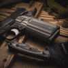 Alien® Predator Green G-10 Grips with a super scoop on a black 1911