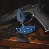 VZ Punch Arrow Blue Black G-10 Dagger with a CZ-75 pistol