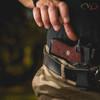 Reaching for VZ Grips' Wilson Combat X9 Boomerang Grip in Black Red G-10 hero photo