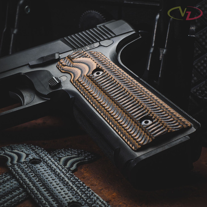Hudson H9 with Alien Hyena Brown grips