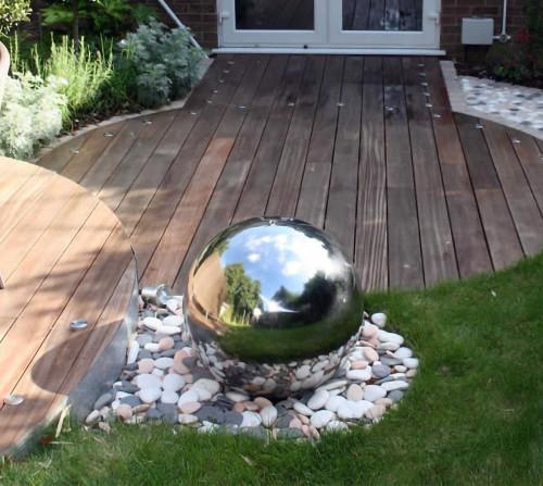 16 Inch Stainless Steel Gazing Ball Hollow Metal Sphere on Rocks
