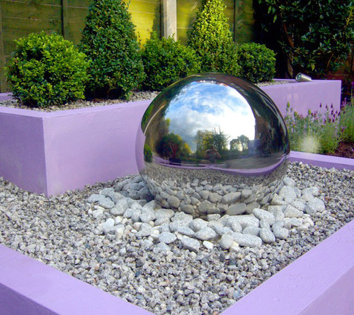 20 inch Stainless Steel Sphere on Rock Garden on Tiered Landscaping