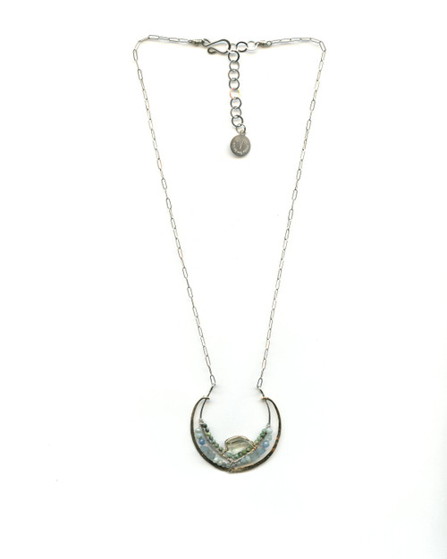 """A green amethyst nugget, chrysocolla, natural aquamarine adorn this hand-formed brass and sterling silver semi circle pendant. 16""""-18"""" necklace."""