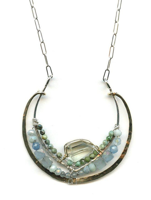 "A green amethyst nugget, chrysocolla, natural aquamarine adorn this hand-formed brass and sterling silver semi circle pendant. 16""-18"" necklace."