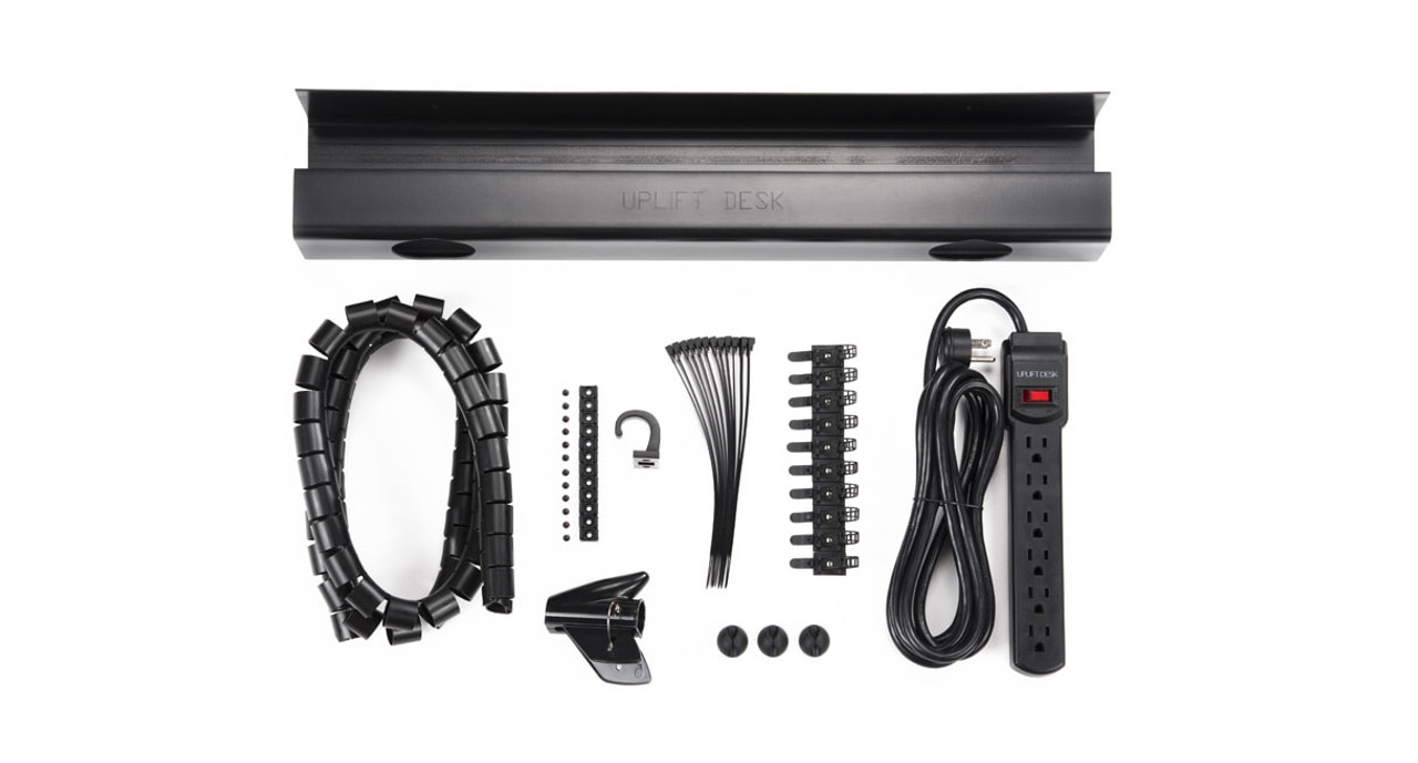 includes wire management tray, 6-outlet surge protector power strip, desk-to