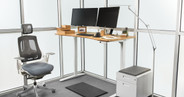 "White UPLIFT V2 Standing Desk Frame with our 60"" x 30"" carbonized bamboo desktop"