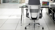 Arm depth can retract to allow user to get closer to worksurface and into tight corners