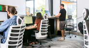 Our White Vert Ergonomic Office Chair in an open office environment