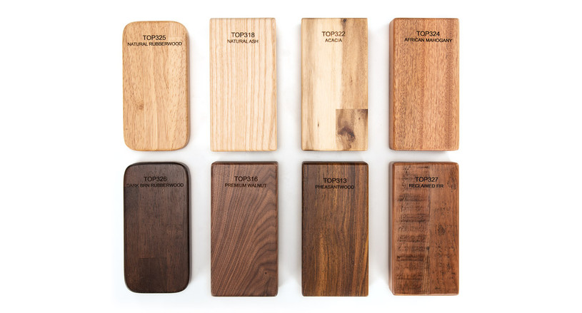 The sample kit includes eight different desktop materials: natural rubberwood, ash, acacia, African mahogany, dark brown rubberwood, walnut, pheasantwood, and reclaimed fir.
