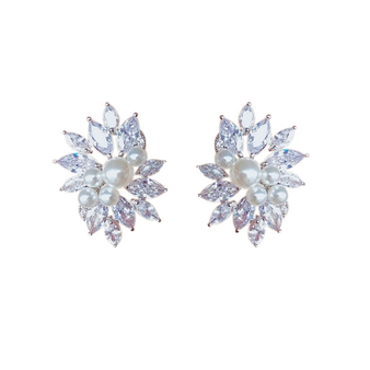 Crystal earrings in a chic elegant design with clear crystals and simulated ivory pearls on a rhodium plated finish.