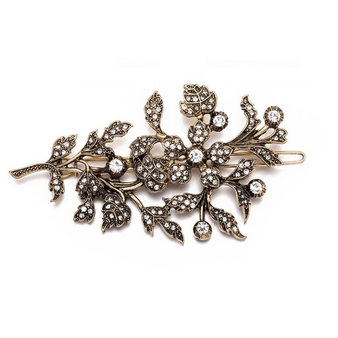 vintage inspired hair clip embellished with clear crystals on an antique gold finish.