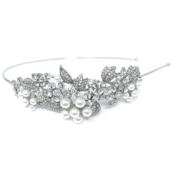 Embellished with clear crystals and simulated ivory pearls on a bed of silver crystal paved leaves.
