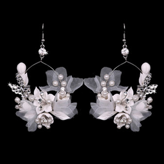 Rhodium plated rhinestone and pearl beaded earrings.