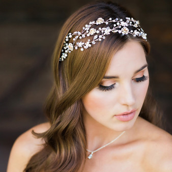 Rhodium plated headband with floral design and crystal/pearl bead accents