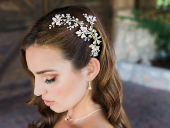 Rhodium plated hair comb with rhinestone and natural pearl bead accents.