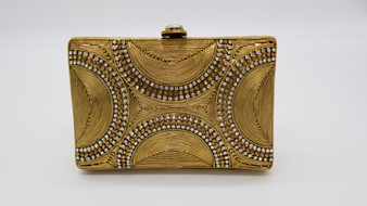 Gold clutch with a circular design made of copper, silver, & gold rhinestones.
