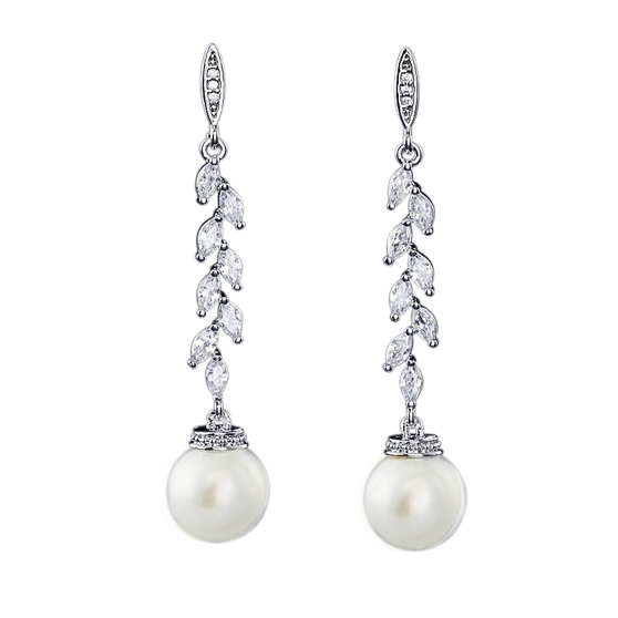 Embellished with high quality cz crystals and simulated ivory pearls on a silver finish.