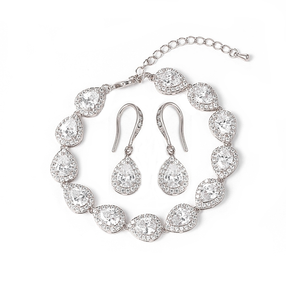 Bracelet is embellished with high quality tear drop shaped crystals on a silver finish. Bracelet has an adjustable chain.