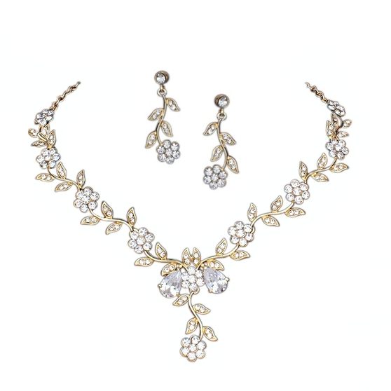 Embellished with sparkly clear crystals on a gold finish. Complete with matching earrings.