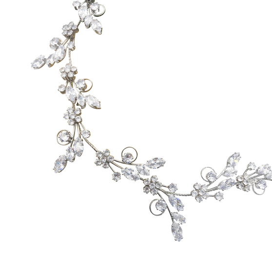 Embellished with high quality clear cut zirconia crystals on a silver vine. Flexible with loops on either end. Includes an ivory ribbon.