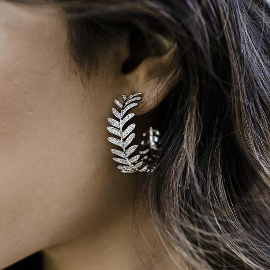 Rhodium plated rhinestone earrings.
