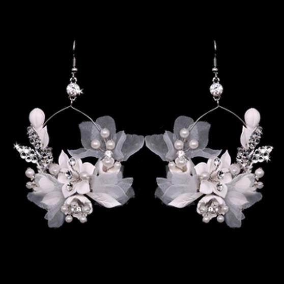 Rhodium plated rhinestone and pearl beaded earrings.
