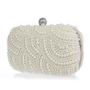 Vintage pearl clutch bag in ivory.