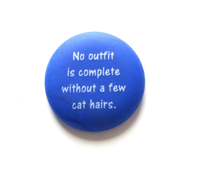 No outfit is complete without a few cat hairs. Pet Stone from Lifeforce Glass, Inc.