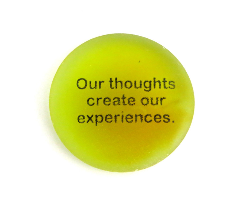 Our thoughts create our experiences, yellow sea stones