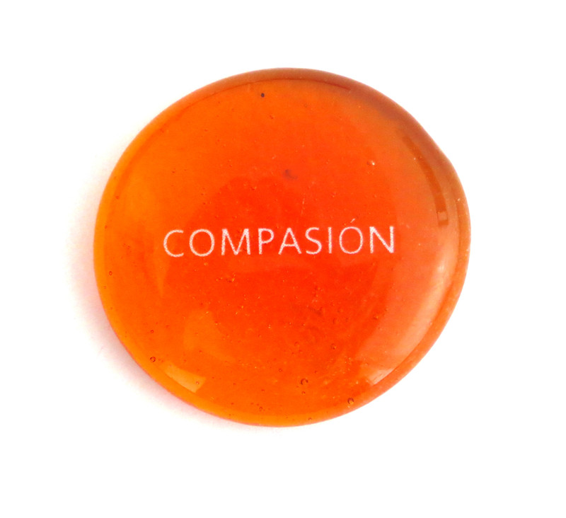 Compasion on orange glass