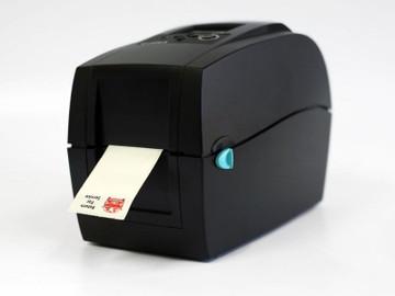 Oil change stickers feeding through the printer system.