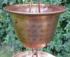 Copper cup on rain chain