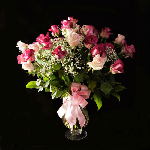 TWO DOZEN PINK PERFECTION IN UPGRADED DESIGNER VASE