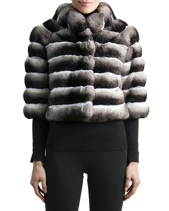 Short Chinchilla  Jacket with turtleneck collar and cropped sleeves elbow length worn over black thin knitted blouse and tight  pants