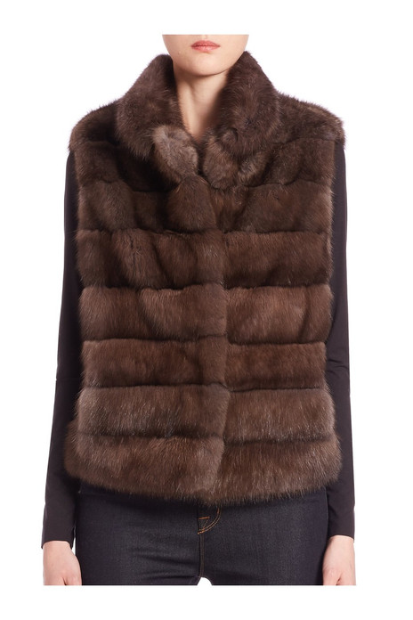light brown sable fur vest with pelts stiched horizontally on model front view fastened
