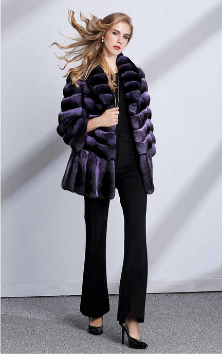 Purple chinchilla coat with wide bottom sweep , 4/5 length cropped sleeves on model wearing black blouse,black bell bottom pants and black leather heels