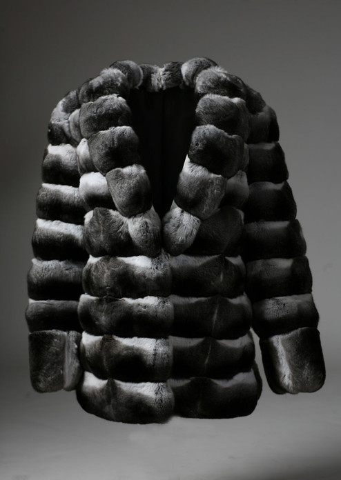 chinchilla  coat with luscious v cut collar , boxy fit , pelts stitched across  and sleeve ending with pelts stiched vertically