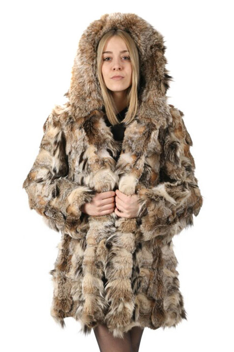 hooded lynx fur coat , mid hip length , made lynx pieces , hood trimmed with canadian lynx , worn by blond model , matching with mini black dress and black leather low cut army boots
