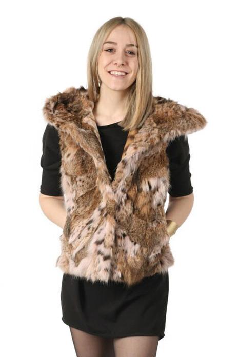 hooded lynx bobcat vest , waist length on blond model  wearing black mini dress and short cut leather boots