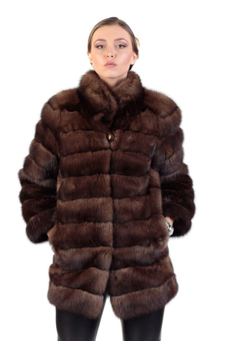 brown sbale fur coat mid hip length , with pelts stiched horizontally , rounded collar on blonde model wearing leather pants
