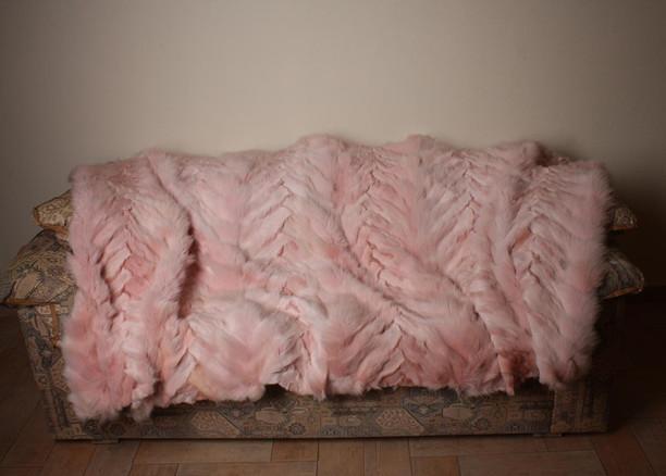 light pink fox fur blanket on sofa chevron pattern