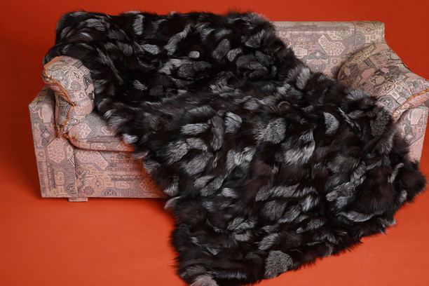 silver fox fur blanket throw on sofa