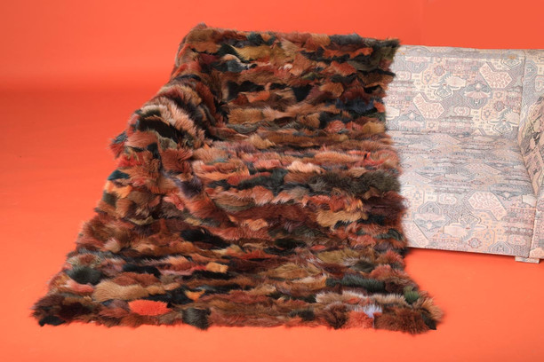multi color fox fur blanket throw on sofa
