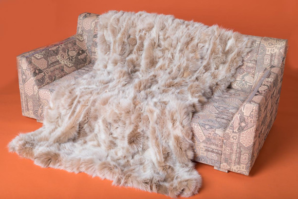 snow top fox fur blanket on couch