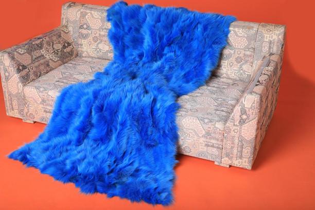 neon blue fox fur blanket throw  on sofa