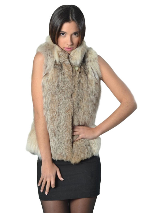 lynx fur vest  , waist lengthwith short stand up round collar on model matched with black mini cocktail dress